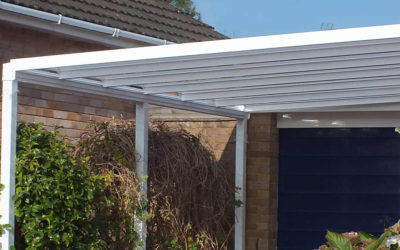 White tassat outdoor canopy installed as a carport.